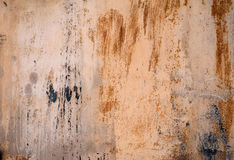 Texture of old wall covered with yellow stucco with traces of pa Royalty Free Stock Photos