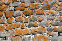 The texture of the old wall of the monastery tower Stock Photo