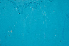 Texture of the old wall, painted in blue paint. Stock Photography