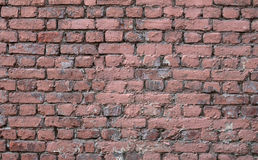 Texture of old wall of red brick, covered with pink Stock Image