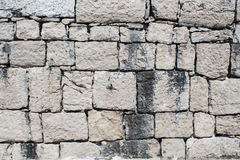 Texture of old wall from squared stone bricks Royalty Free Stock Images