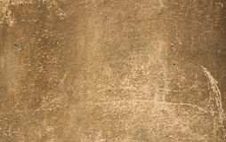 Texture of old walls are covered with yellow stucco Royalty Free Stock Image