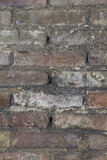 Texture of a old wheathered an repaired brick wall Stock Photos
