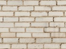 Texture of the old white brick wall. The seamless texture of the old white brick wall stock image