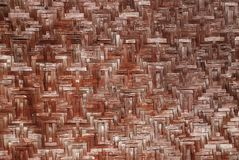 Texture of the old wicker mat of bamboo red color Stock Images