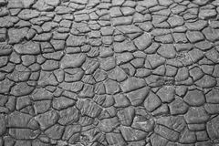 Texture of the old withered ruberoid on the surface of the above-ground pipe. Royalty Free Stock Photography