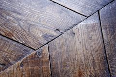 The texture of old wood in brown with nails royalty free stock photo