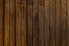 Texture of old wood fence alight with the rays of the setting su. N.old rough not polished Stock Photo