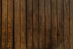 Texture of old wood fence alight with the rays of the setting su. N.old rough not polished Stock Photography