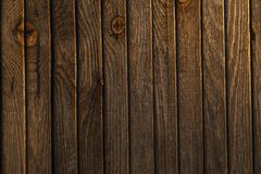 Texture of old wood fence alight with the rays of the setting su. N.old rough not polished Stock Images