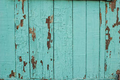 The texture of old wood with paint peeling off. Stock Photography