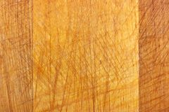 Texture of old wooden cutting board with scratches. Natural wood background Royalty Free Stock Photography