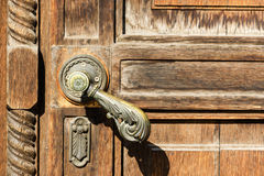 Texture of old wooden door with a metal handle Royalty Free Stock Image