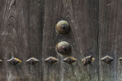 Texture on old wooden door pinned with rusty metal in Japan Royalty Free Stock Image