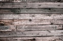 The texture of the old wooden fence with chopped off knots and cracks. Wallpaper for vintage design royalty free stock photo