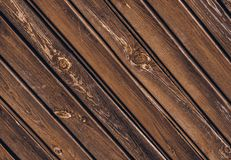 Texture of old wooden fence with skew boards royalty free stock photo