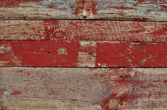 Texture of old wooden planks with red paint Royalty Free Stock Photo