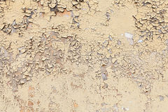 Texture of old yellow cracked wall Stock Photos
