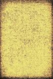 The texture of old yellow paper. Abstract grunge background. Grunge background of old paper for printing on labels, posters, business cards and creating your own Stock Photography