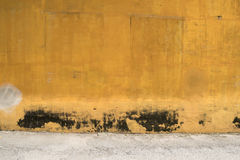Texture of old yellow vintage wall of industrial factory Stock Image