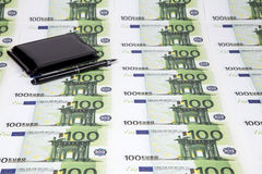 Texture of one hundred euro and wallet with pen Stock Photography
