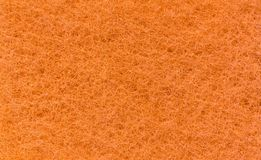 Texture of an orange cloth as a background. Royalty Free Stock Photo