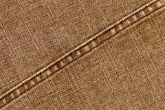 Texture orange de tissu de jeans avec le point Images stock