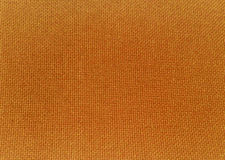 Texture of orange fabric. Details of woven texture in a piece of orange colored fabric. Suitable for abstract background Royalty Free Stock Images