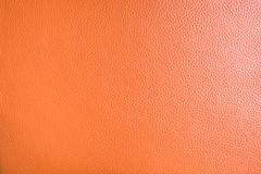 Texture of orange genuine leather. For background or graphic resources Royalty Free Stock Image
