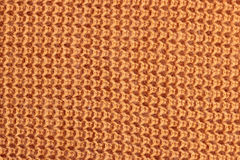 Texture of a orange knitted sweater Stock Photography