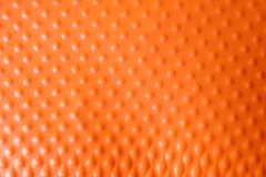 Texture of orange plastic cup as background. Closeup royalty free stock images