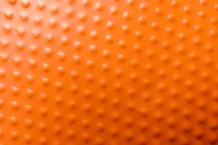 Texture of orange plastic cup as background. Closeup stock images