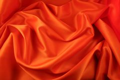 Texture orange satin Stock Images