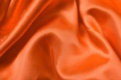 Texture orange satin Stock Images