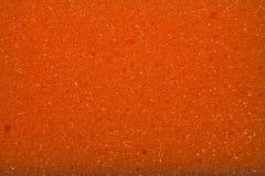 Texture of orange sponge. Macro Stock Image