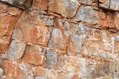 The texture of the orange stones in the rock. Royalty Free Stock Photo