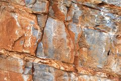 The texture of the orange stones in the rock. Royalty Free Stock Images