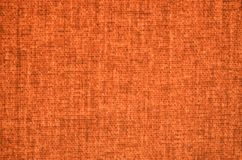 Texture of orange tarpaulin Royalty Free Stock Photography