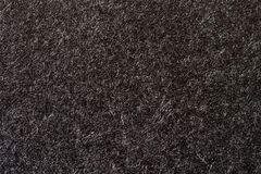 Texture of organic black paper for artwork with numerous natural inclusions. Modern dark background, backdrop, substrate Royalty Free Stock Images