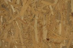 Texture of OSB with the strips lying unevenly across each other Stock Photos