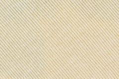 Texture ou fond tricotée jaune-clair de tissu Photo libre de droits