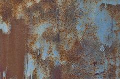 Texture painted blue with brown metal corrosion. Old ground stock photos