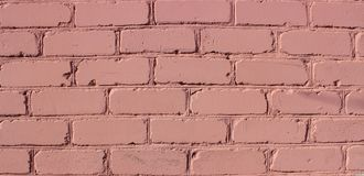 Texture of painted brown brickwork. Old wall, built over 100 years ago stock photos