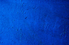 Texture painted concrete wall. The surface of the old cracked concrete wall painted in blue like space Royalty Free Stock Photos
