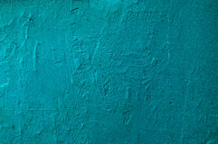 Texture painted concrete wall. The surface of the old cracked concrete wall painted in green Royalty Free Stock Images