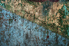 Texture painted concrete wall. The surface of the old cracked concrete wall with peeling paint Stock Images