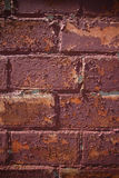 Texture of painted cracked and peeled off red brick wall Stock Photography