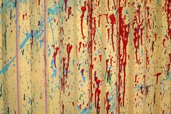 The texture of the painted fence.  yellow background with red spots royalty free stock image