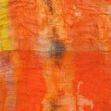 Texture of painted orange silk batik Royalty Free Stock Photography