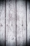 Texture of the painted shabby wooden flooring made of boards, grunge background. The texture of the painted shabby wooden flooring made of boards, close up royalty free stock image